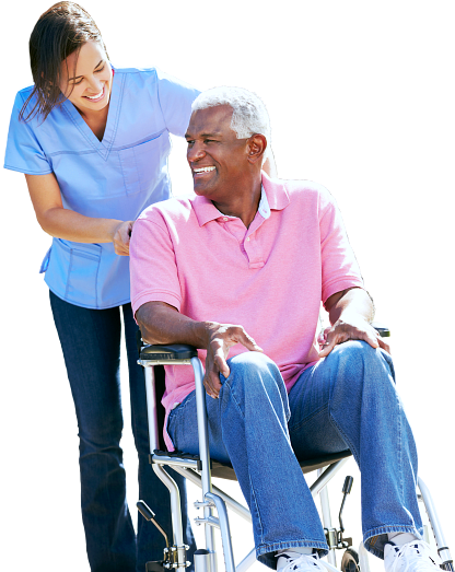 smiling old man in a wheelchair assisted by his caregiver